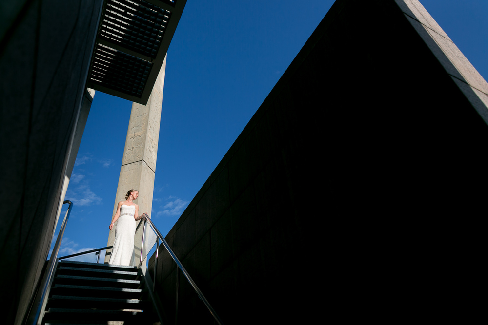 A photo of one of the brides standing at the top of the stairs outside the National Art Gallery