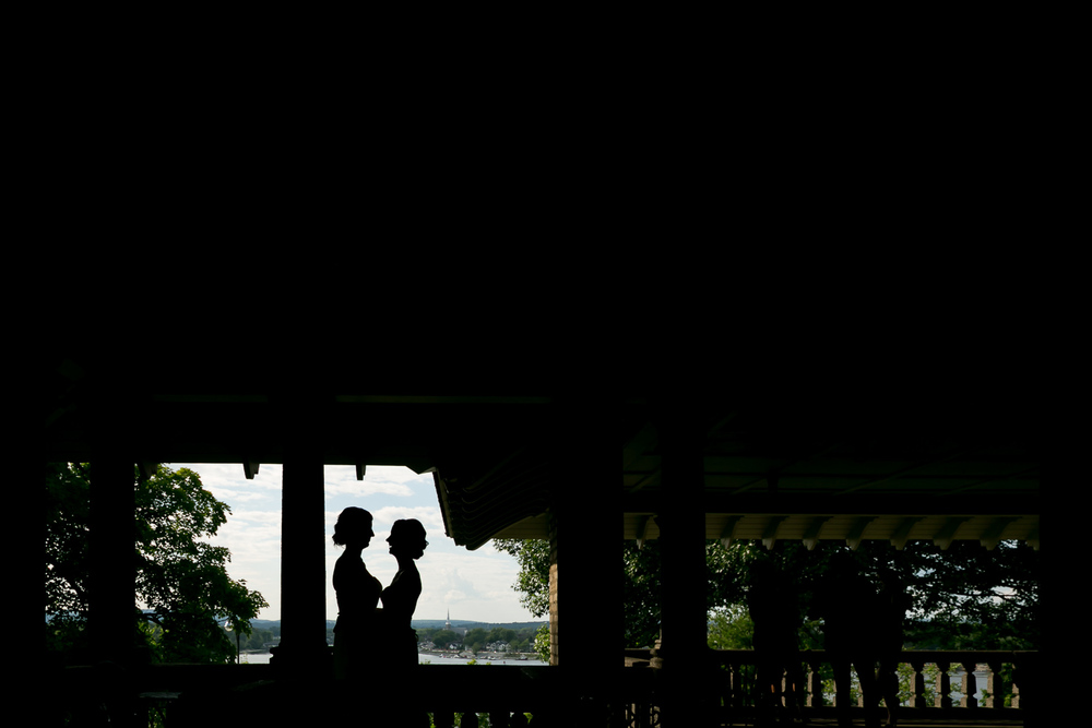 A silhouette of the brides standing in the Rockcliffe Pavilion