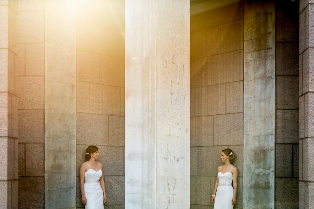 A portrait of the brides standing amongst the pillars outside the National Art Gallery