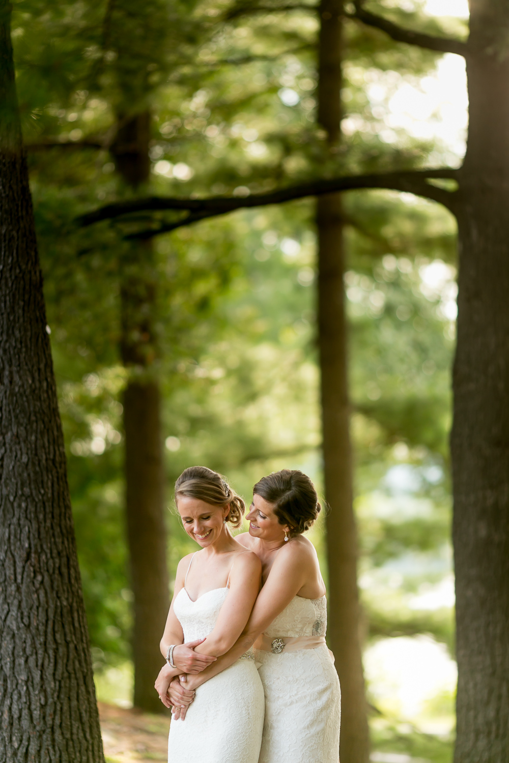 A photo of the brides standing amongst the tree near the Rockcliffe Pavilion