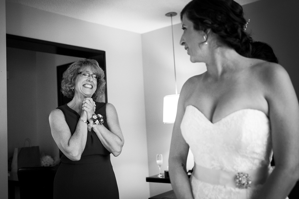 The mother of the bride seeing her daughter in her wedding dress for the first time