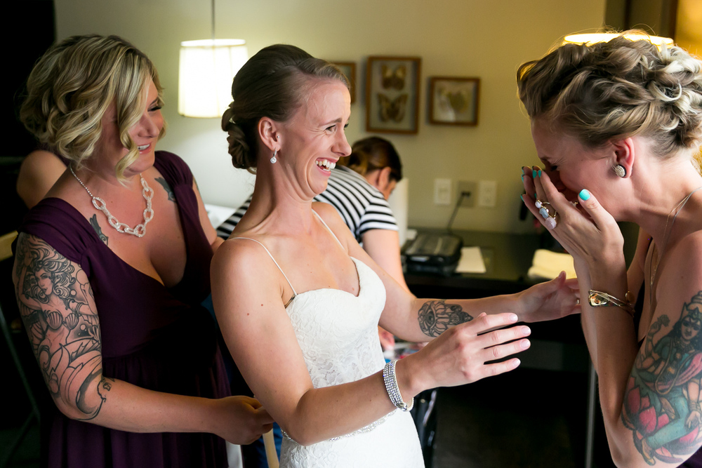 The bride and her bridesmaids getting ready together