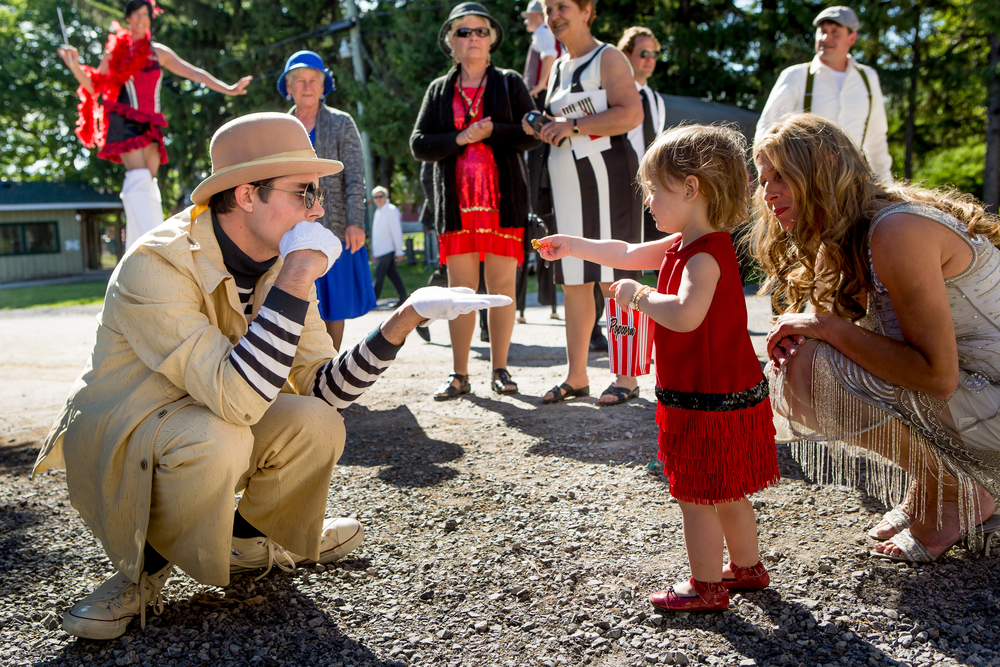 A circus performer entertaining a young guest before the wedding reception