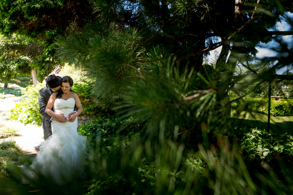 A photo of the bride and groom amongst the trees at the Experimental Farm