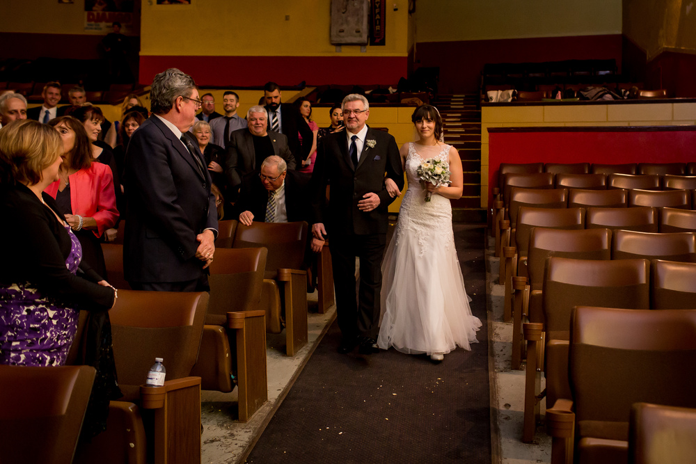 The bride walking down the aisle with her father
