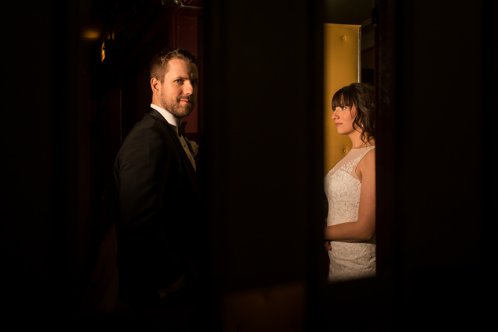 A portrait of the bride and groom inside the Mayfair Theatre