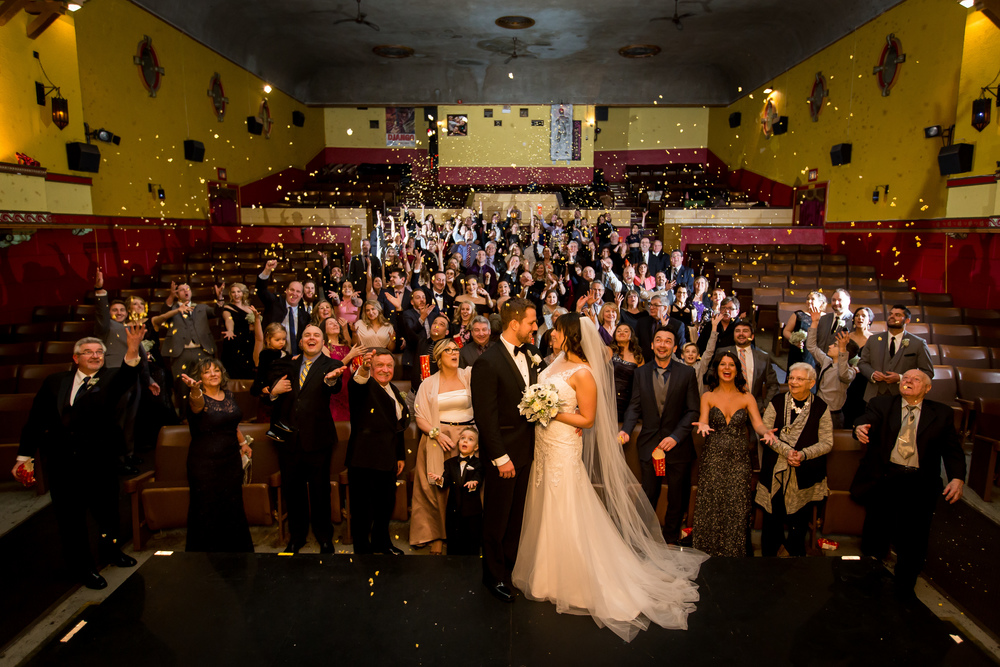 The guests doing a popcorn toss to celebrate after the ceremony at The Mayfair Theatre