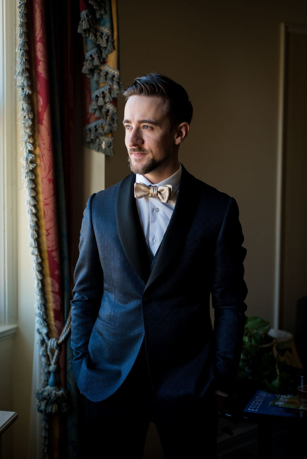 A portrait of the groom before the ceremony