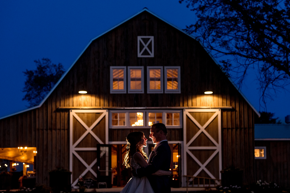 stephanie and steve nighttime portrait in the forest of stonefields heritage barn wedding