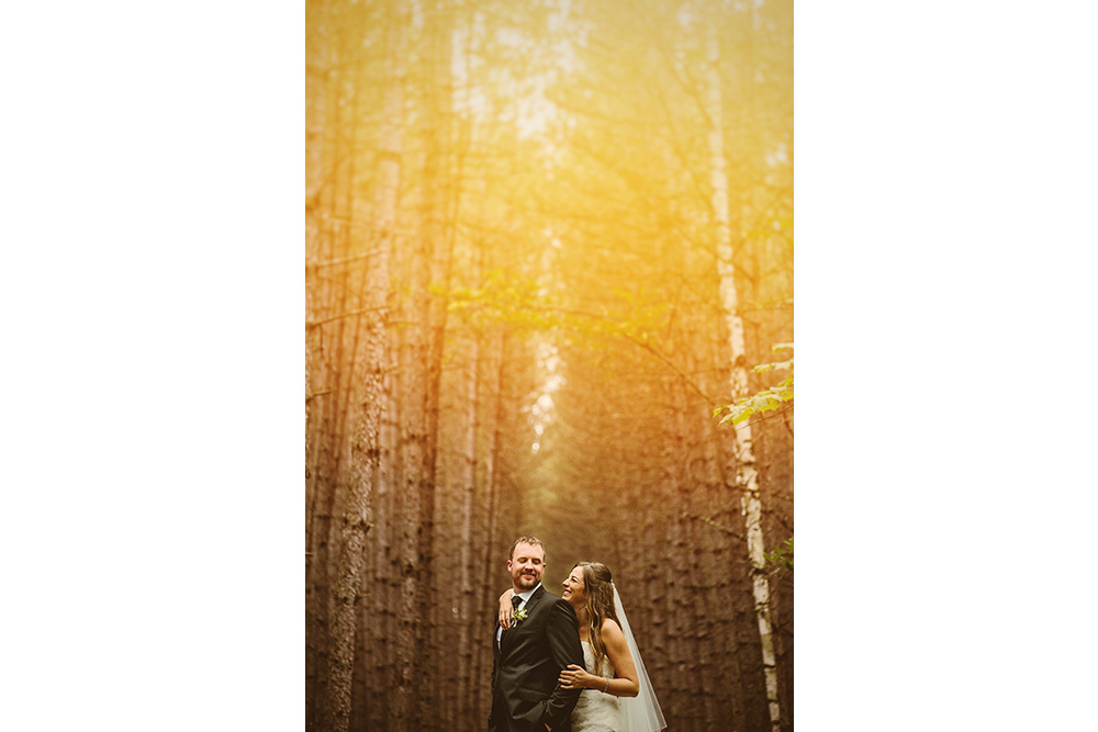 bride and groom in a forest at the grand lodge in mont tremblant quebec