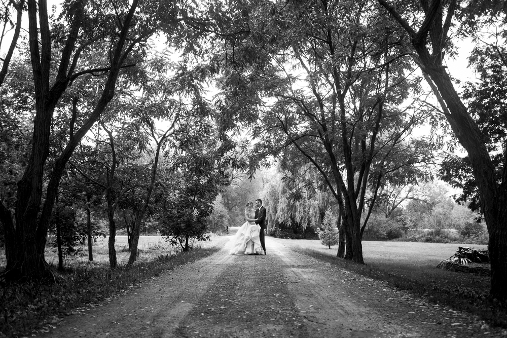 A photo of the bride and groom during their wedding at Stonefields Heritage Farm