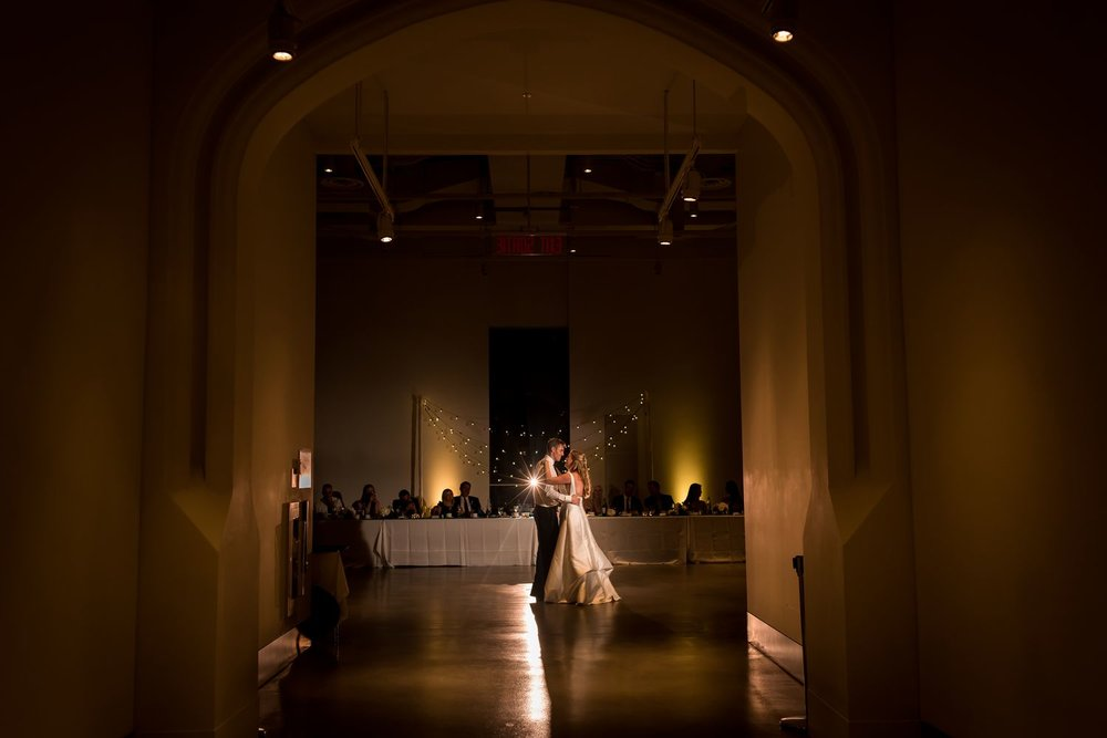 The bride and groom during their first dance at their wedding reception at the Museum of Nature