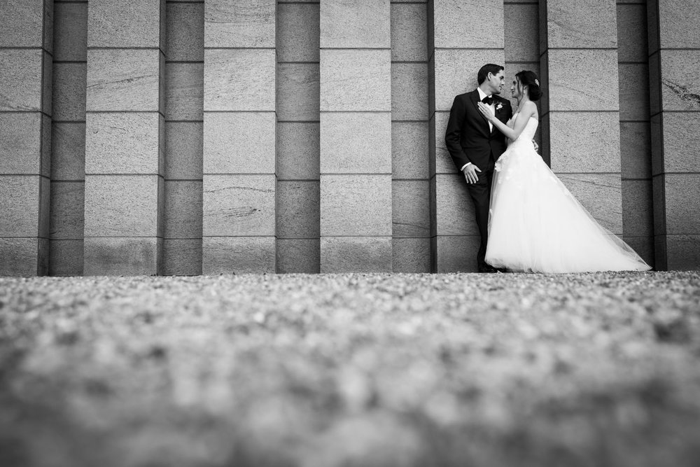 Wedding photograph of a bride and groom outside near the national art gallery