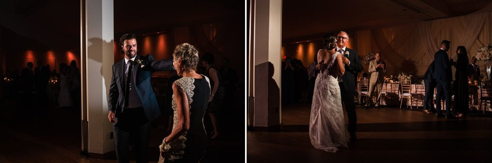 The bride and groom having their first dances with their parents at the Centurion Conference Centre wedding reception