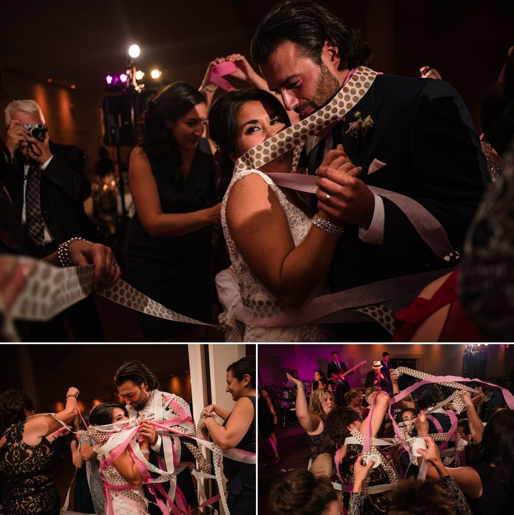 The bride and groom during their ribbon dance at their wedding reception at the Centurion Conference Centre