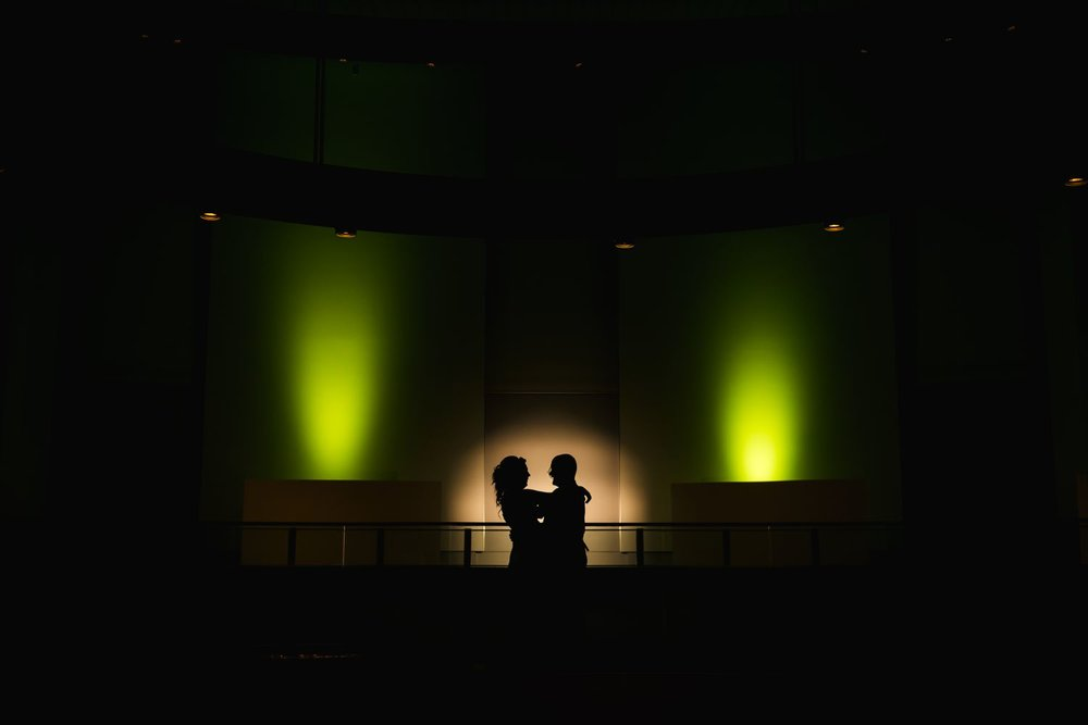 A nighttime silhouette photo of the bride and groom after their wedding and reception at The Museum of Nature in downtown Ottawa