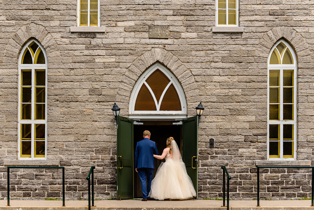 bride-and-father-enter-patricks-church-at-a-wedding-in-richmond-ontario.jpg