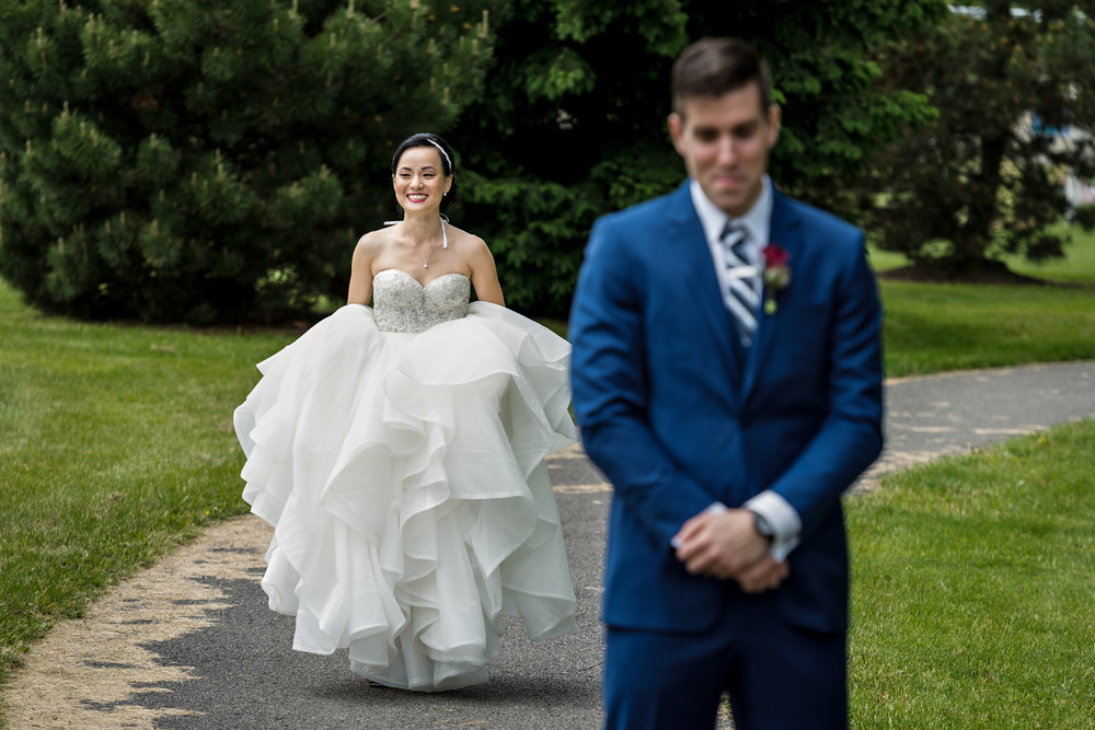 bride-and-groom-have-their-first-look-before-their-sidedoor-restaurant-wedding-in-ottawa-ontario.jpg