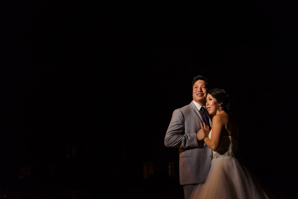 A night-time portrait taken of the bride and groom after their wedding reception outside The Glebe Community Centre in Ottawa