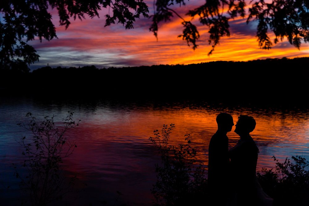 A portrait of the bride and groom taken at sunset at La Grange de la Gatineau