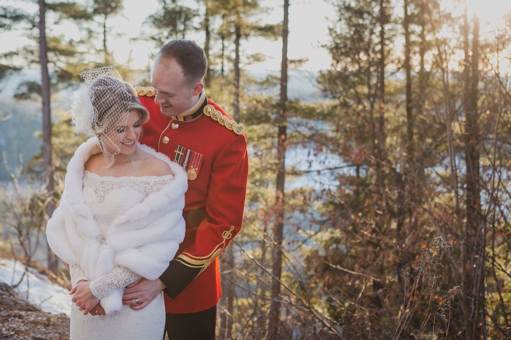 A outdoor portrait of the bride and groom after their winter wedding ceremony at Le Belvedere in Wakefield Quebec