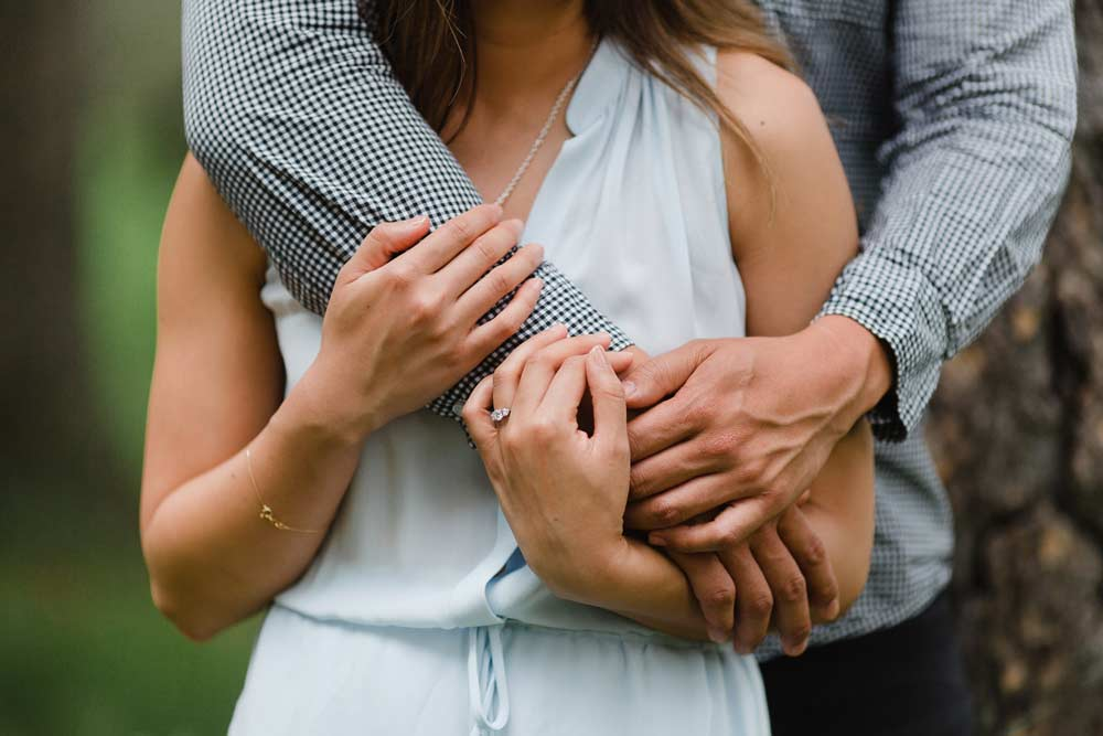 close up of a couple embracing during their engagement shoot