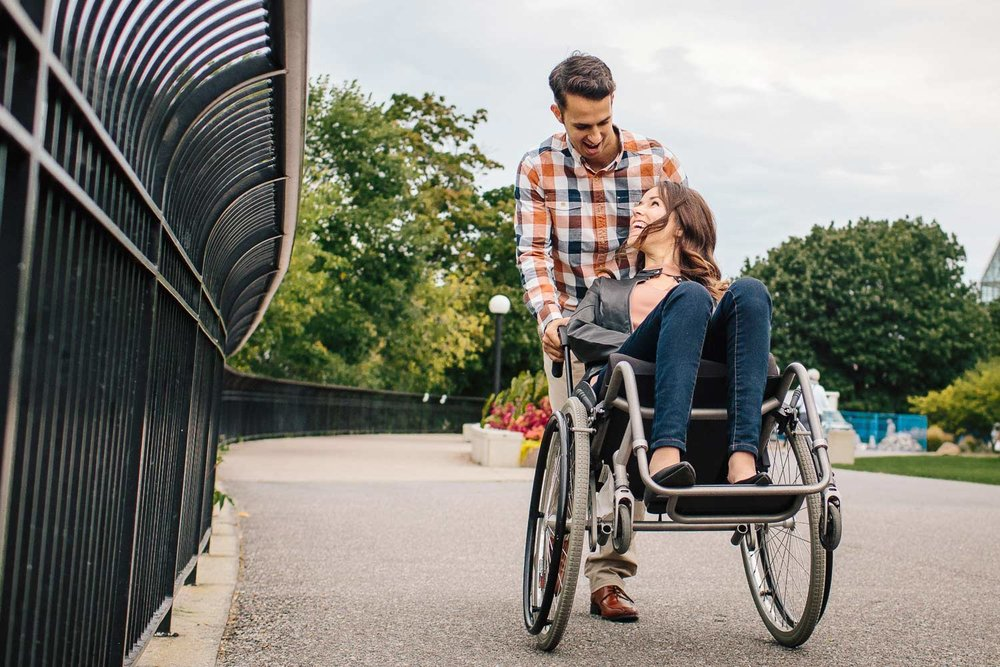 cute engagement photo with a handicapped woman and her fiance