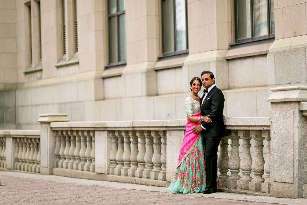 Hindu Indian wedding couple in downtown ottawa outside the Chateau Laurier