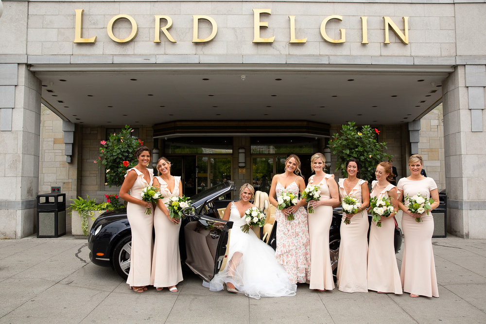 wedding party photo in front of the lord elgin hotel