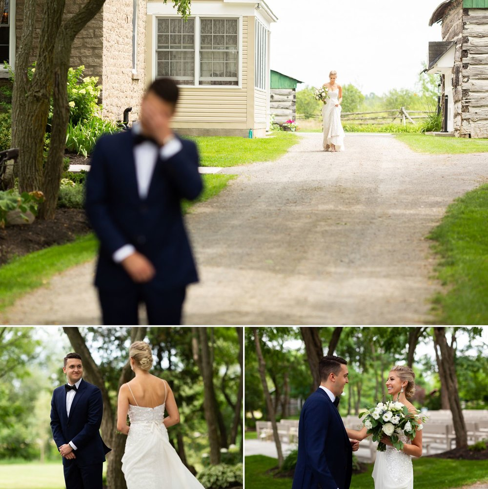 The bride and groom during their first look outside Stonefields Estate