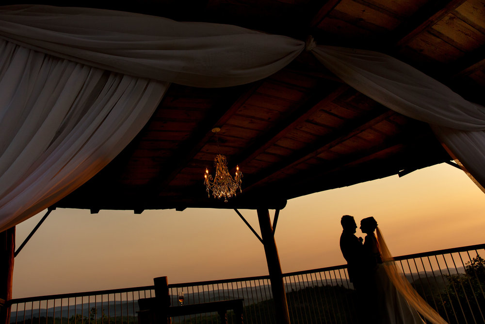 sunset photo of a bride and groom at le belvedere