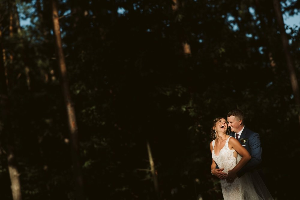 bride and groom candid sunset portrait at a hunt and golf club wedding in ottawa ontario