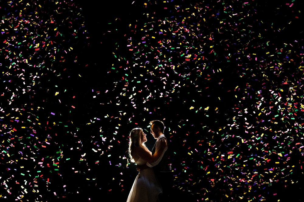 confetti portrait with bride and groom at night