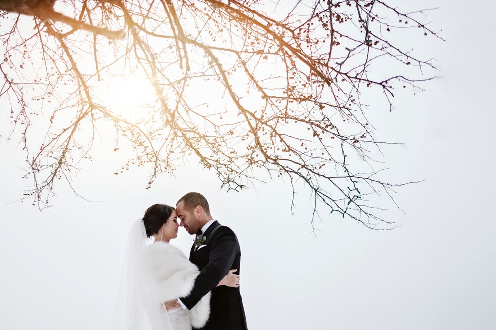 a winter portrait of a bride and groom at the hotel quintessence in mont tremblant quebec