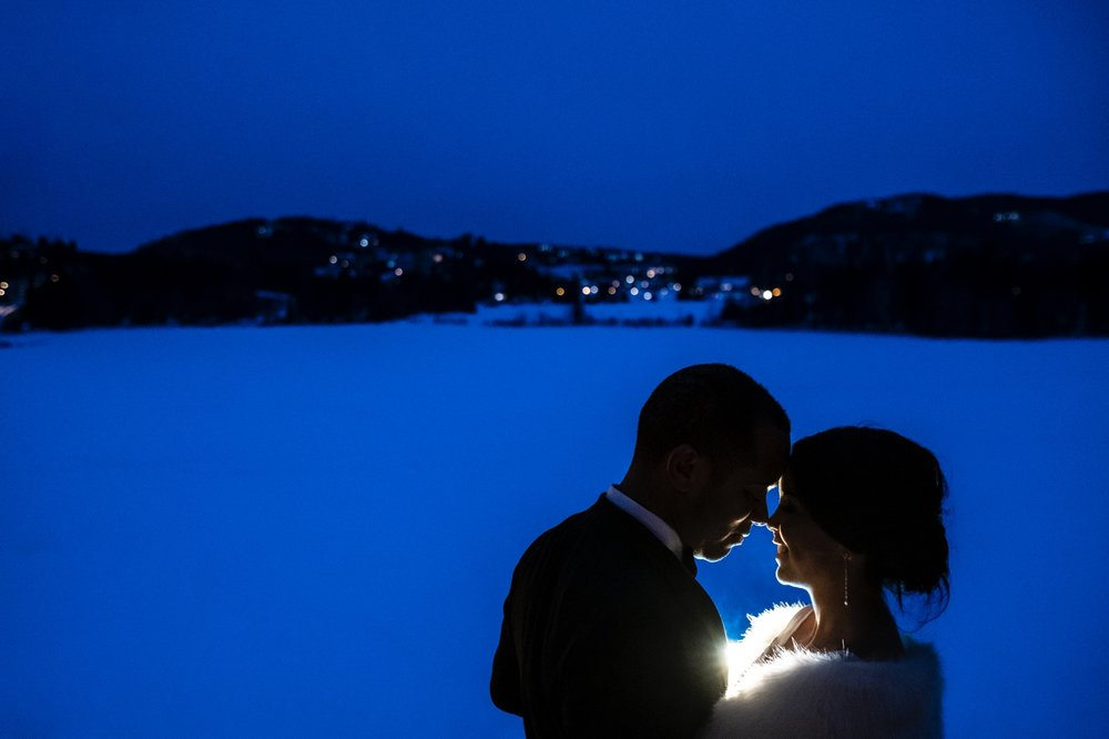 a nighttime winter portrait of a bride and groom at the hotel quintessence in mont tremblant quebec