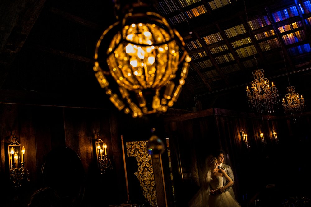 nighttime portrait of bride and groom during an evermore weddings and events wedding reception in almonte ontario