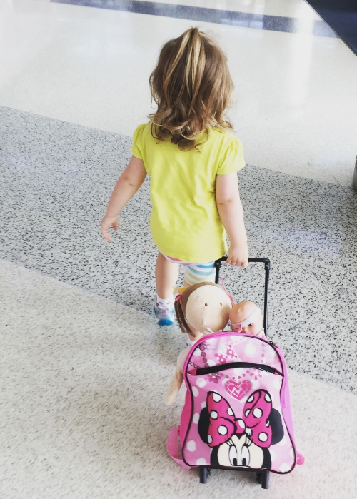 penelope seriously dug the airport. she insisted on carting her own luggage with baby + dolly in tow.