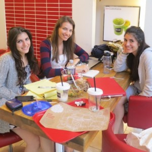 Isabel, Tanyella and Talie working at a local cafe