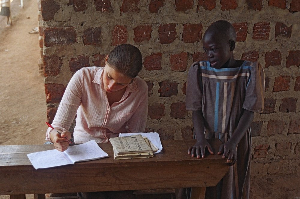 """When I was 17, I volunteered as a teacher for a year in Uganda, and it was a year that changed my life. At the school where I worked, books were so scarce that they were kept under lock and key in the principal's office. I had just one textbook to teach a class of 40 students."""
