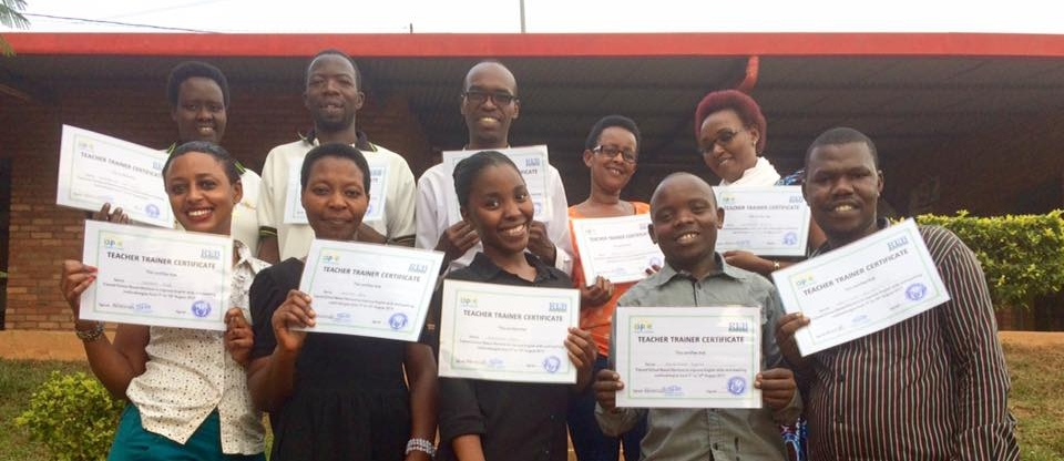 Umubano Primary School teachers holding their completed teaching and teacher training certificates. Photo credit: UPS