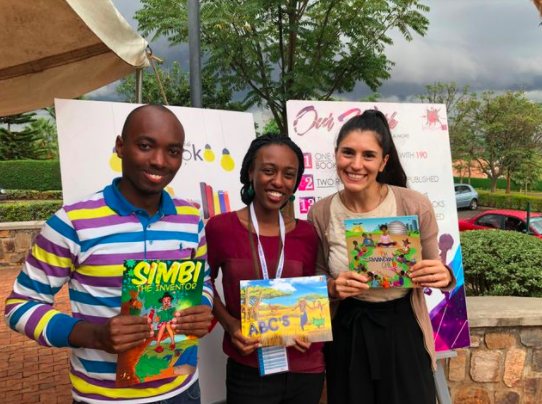 The ImagineWe Publishing Team and our Director of Business Development, Isabel Sheinman, holding ImagineWe's highly popular published books in Rwanda.