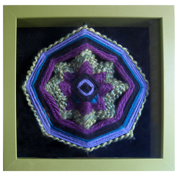 "Ojo de Dios of the Lavender Fields 10"" square Yarn, wood dowels, shadow box Sold to Private Collector."
