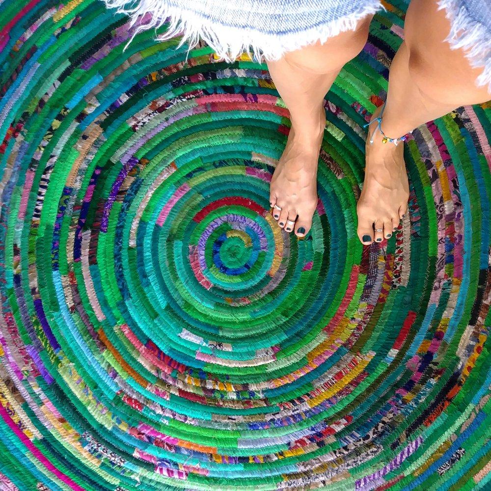 feet on green spiral rug.jpg