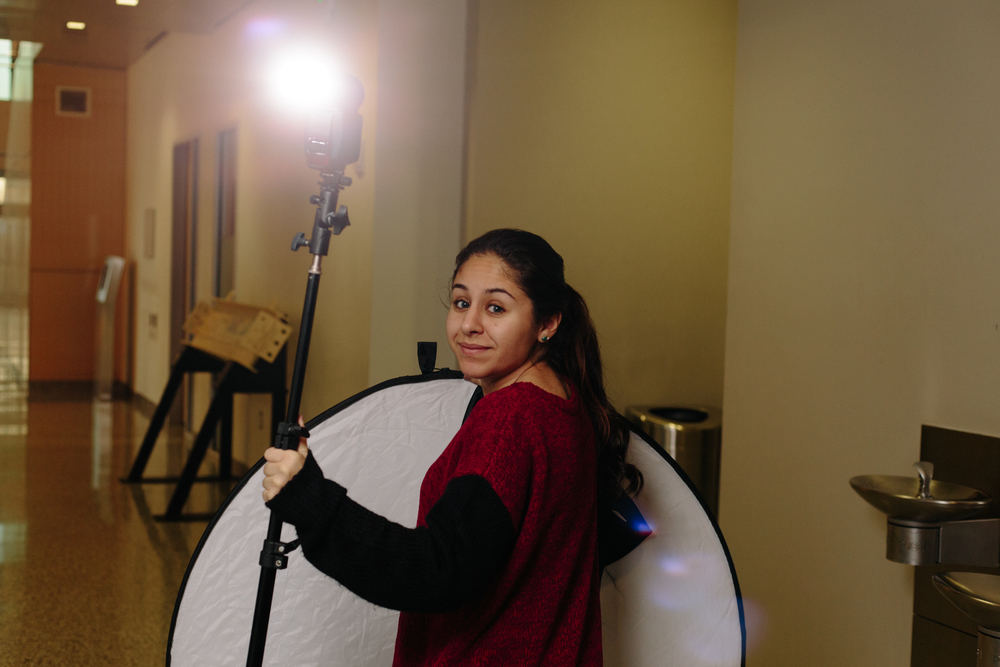 My lovely assistant holding a light-stand and reflector.