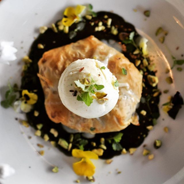 Back by popular demand! Our Chocolate & Pistachio Bisteeya!! Delicious filo pastry filled with chocolate & pistachio cookie dough goodness served warm on chocolate ganache with vanilla ice cream, the perfect winter treat ❄️ #happyhumpday🐫 #eathouse #eathousediner #chocolate #dessert #sydneyeats #sydneyfood #sydneyfoodie #redferneats #redfernbars #redfernlocal