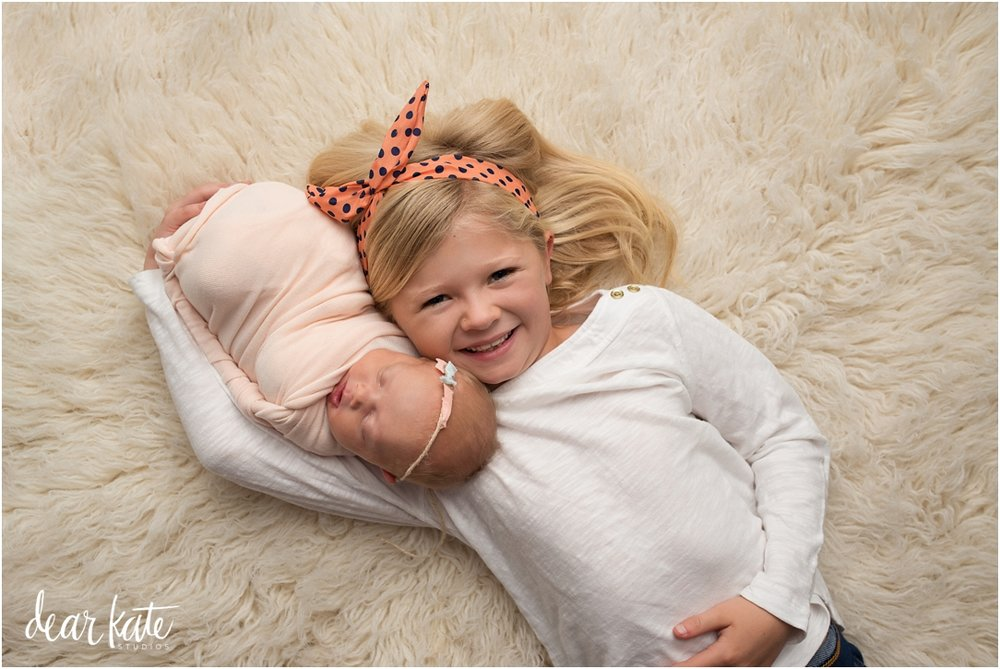 newborn and big sister loveland baby pictures.jpg