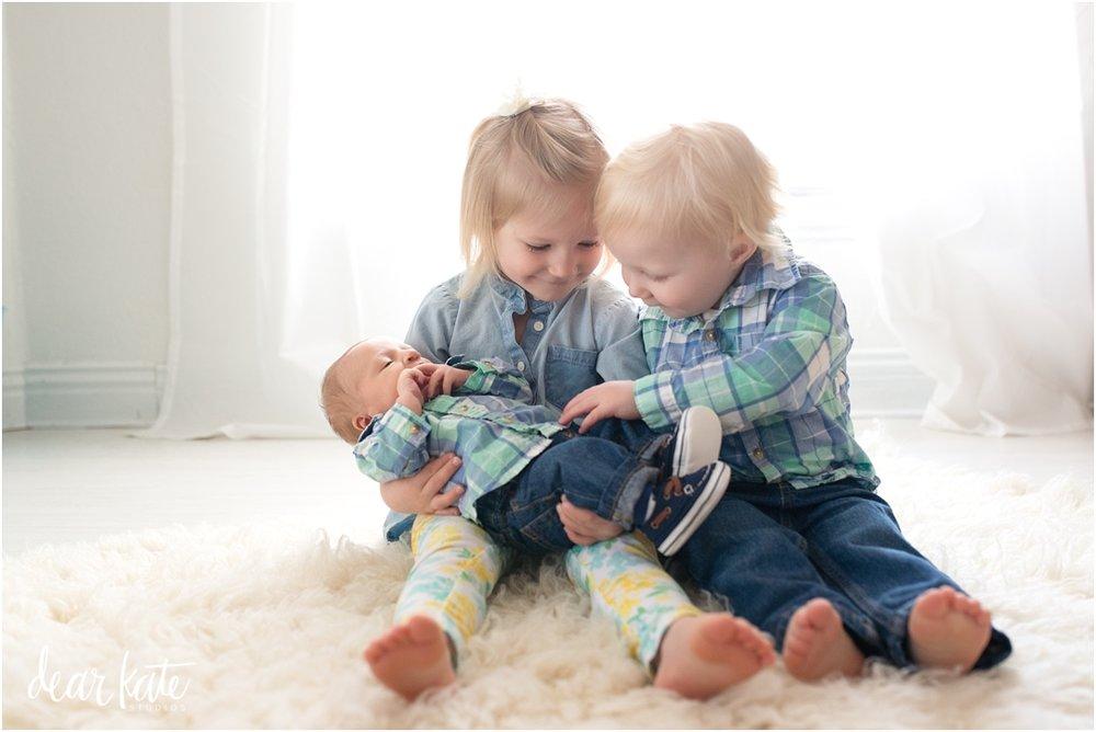 newborn with siblings loveland co newborn photographer evans co.jpg