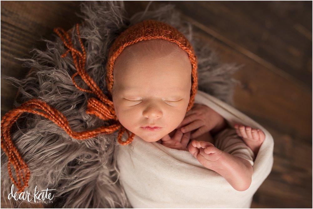 -ft-collins-baby-photographer-sleeping-baby-boy-orange.jpg