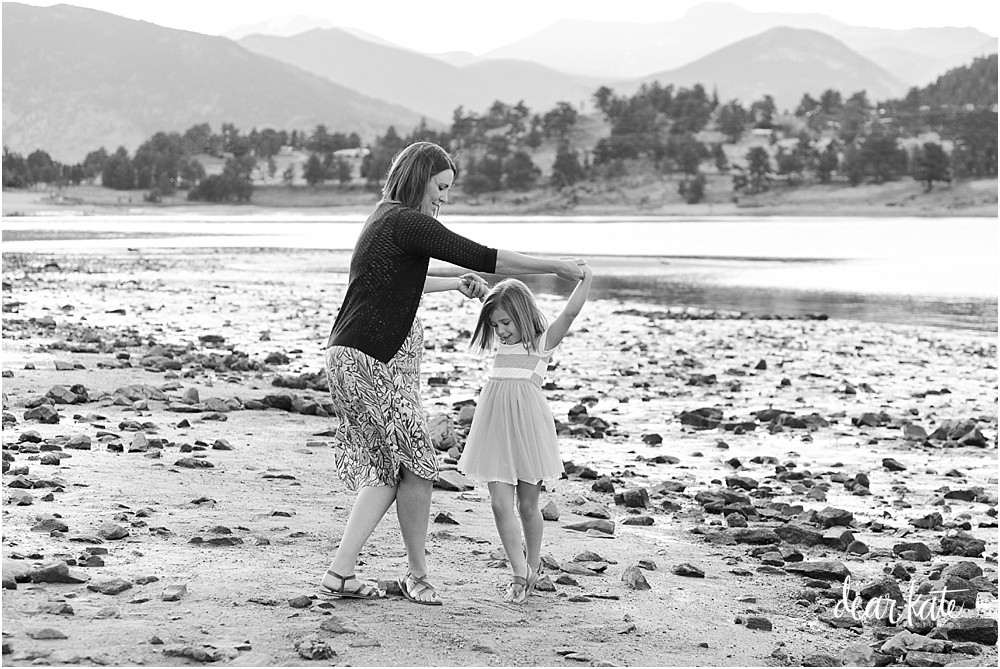 dancing mother and daughter on beach of mary's lake estes park Colorado