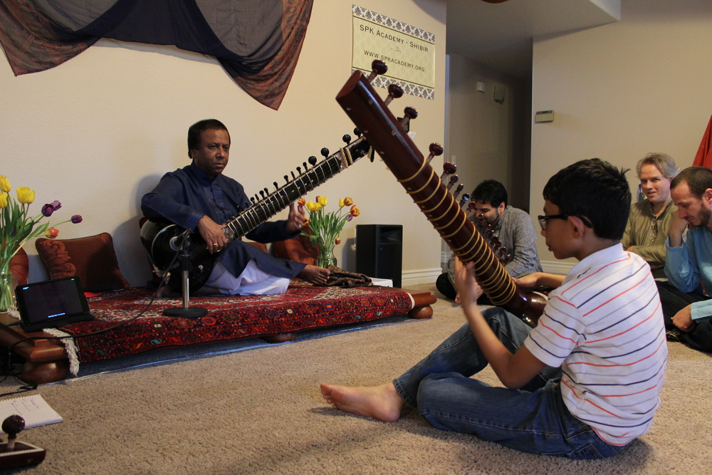 Ustad Shahid Parvez Khan teaching sitar to one of our youngest students, Vishwesh.